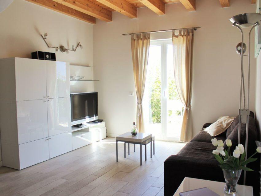 Zona giorno con divano letto e TV-SAT - Casa Nr.1